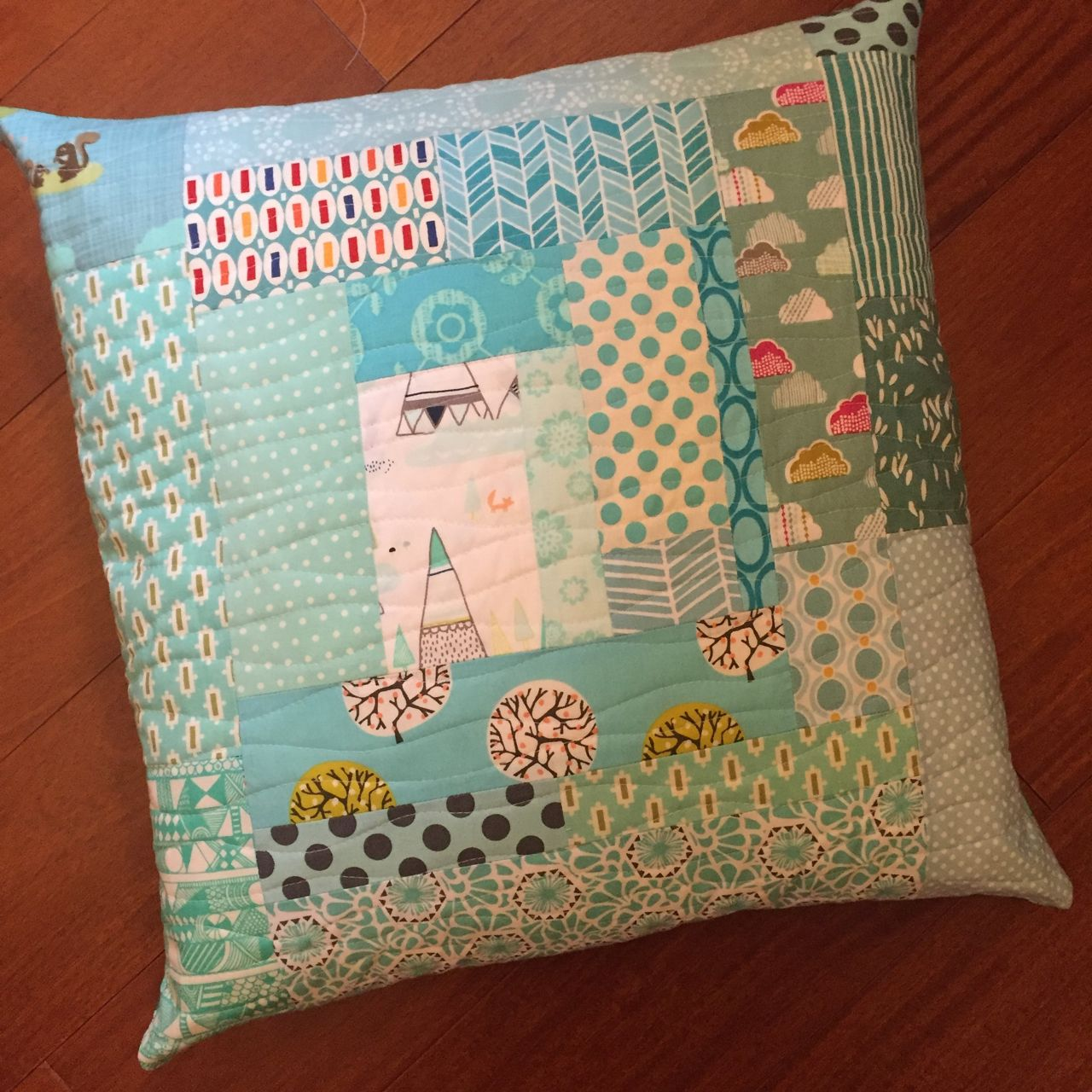 quilted aqua cushion