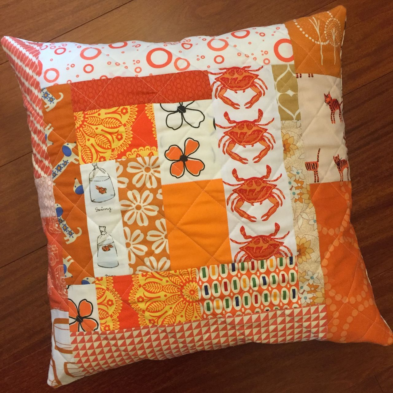 quilted orange cushion