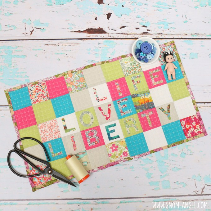 Life, Love, Liberty a mini quilt tutorial by Angie Wilson of www.GnomeAngel.com using Sizzix Big Shot Pro and Dies with Liberty and Ella Blue Hanky Linen.